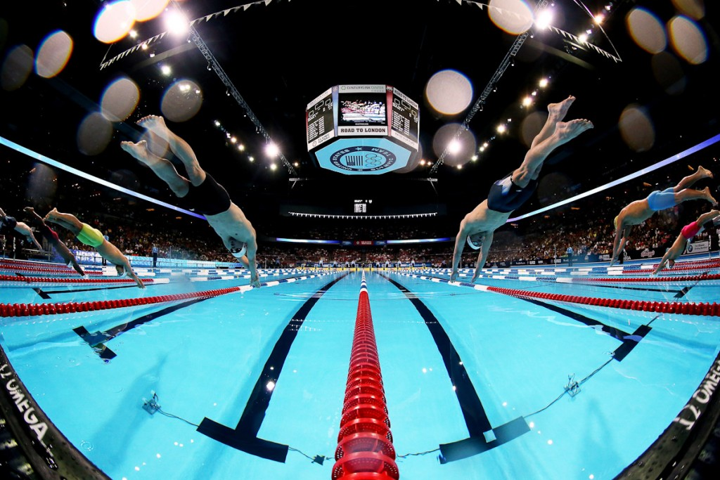 OMAHA, NE - JUNE 30: (L-R) Davis Tarwater and Michael Phelps dive off of the starting block at the start of the second semifinal heat of the Men's 100 m Butterfly during Day Six of the 2012 U.S. Olympic Swimming Team Trials at CenturyLink Center on June 30, 2012 in Omaha, Nebraska. (Photo by Al Bello/Getty Images) *** Local Caption *** Davis Tarwater; Michael Phelps